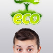 Young girl looking at green eco sign — 图库照片