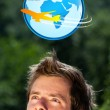 Young head looking at vacation type of sign — Stock Photo #6855470