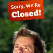 Young persons head looking at closed and open signs — Stock Photo #6855508