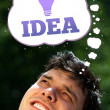 Young person looking at idea type of sign — Stock Photo