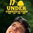Young head looking at contruction icons — Stock Photo #6855656