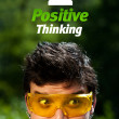 Young head looking at positive negative signs — 图库照片