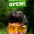 Young persons head looking at closed and open signs — Stock Photo #6855854