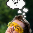Young head thinking with clouds — Stock Photo