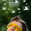 Young head looking at social type of icons and signs — Stock Photo #6856247