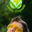 Young head looking at green eco sign — Stock Photo #6856248