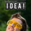 Young person looking at idea type of sign — Stock Photo #6856349