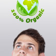 Young head looking at green eco sign — Stock Photo #6856533
