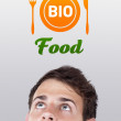 Young head looking at healthy food sign — Stock Photo #6856566