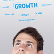 Young persons head looking at business icons and images — Stock Photo