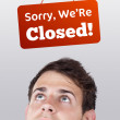 Stock Photo: Young persons head looking at closed and open signs