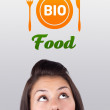 Young girl looking at healthy food sign — Stock Photo