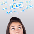 Young girl looking at social type of icons and signs — Stock Photo #6856845