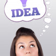 Young girl looking at idea type of sign — Stock Photo #6856869