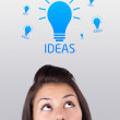 Young girl looking at idea type of sign — Stock Photo #6856881