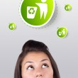 Young girl looking at green eco sign — Stock Photo