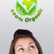 Young girl looking at green eco sign — Stock Photo #6857037