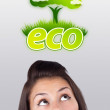Young girl looking at green eco sign — Stok fotoğraf