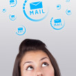 Young girl looking at support contact type of icons and signs — Stock Photo #6857067