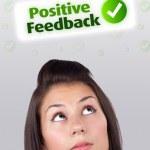 chica joven mirando señales negativas positivas — Foto de Stock