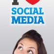 Young girl looking at social type of icons and signs — Stock Photo #6857170