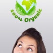 Young girl looking at green eco sign — Foto de Stock