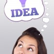 Young girl looking at idea type of sign — Stock Photo