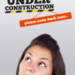 Young girl looking at contruction icons — Stock Photo