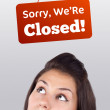 Young girl head looking at closed and open signs — Stock Photo