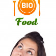 Young girl looking at healthy food sign — Stock Photo #6857416