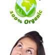 Young girl looking at green eco sign — Stock Photo #6857420