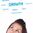 Young girl head looking at business icons and images — Stock Photo #6857431