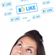 Young girl looking at social type of icons and signs — Stock Photo