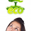 Young girl looking at green eco sign — Stock Photo #6857436