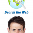 Young head looking at internet type of icons — Stock Photo