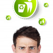 Royalty-Free Stock Photo: Young head looking at green eco sign