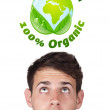 Stock Photo: Young head looking at green eco sign