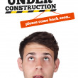 Royalty-Free Stock Photo: Young head looking at contruction icons