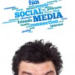 Young head looking at social type of icons and signs — Stock Photo #6857846