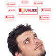 Young head looking at social type of icons and signs — Stock Photo #6858098