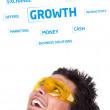 Голова молодых людей, глядя на бизнес иконок и изображений — Стоковое фото