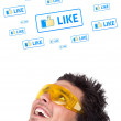 Young head looking at social type of icons and signs — Stockfoto
