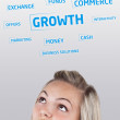 Young girl head looking at business icons and images — Stock Photo