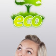Young girl looking at green eco sign — Stock fotografie