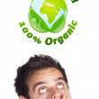 Young head looking at green eco sign — Stock Photo #6859505