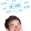 Young head looking at social type of icons and signs — Stock Photo