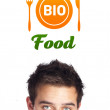 Young head looking at healthy food sign — Foto Stock