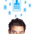 Young head looking at social type of icons and signs — Stock Photo #6859748