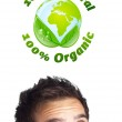 Young head looking at green eco sign — Stock Photo #6859935