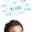 Young head looking at social type of icons and signs — Stock Photo #6859951